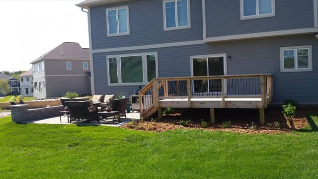 Landscaping done on a new build which indcludes new plantings, mulch beds, and a patio